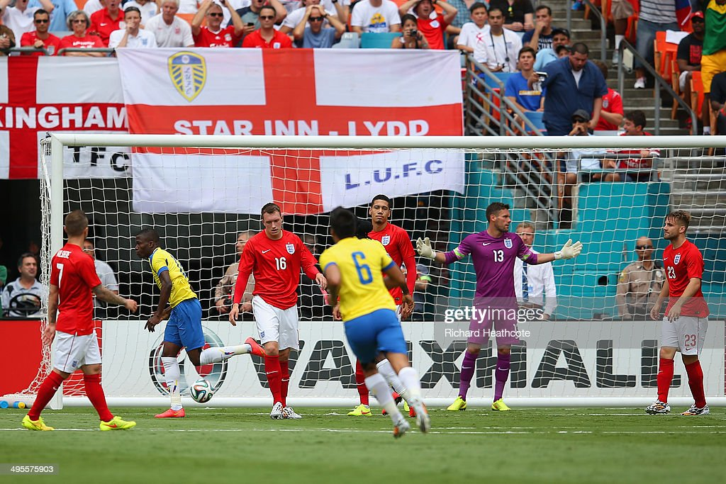 <a gi-track='captionPersonalityLinkClicked' href=/galleries/search?phrase=Enner+Valencia&family=editorial&specificpeople=6898122 ng-click='$event.stopPropagation()'>Enner Valencia</a> of Ecuador turns to celebrate after scoring the first goal as Ben Foster of England reacts during the International friendly match between England and Ecuador at Sun Life Stadium on June 4, 2014 in Miami Gardens, Florida.