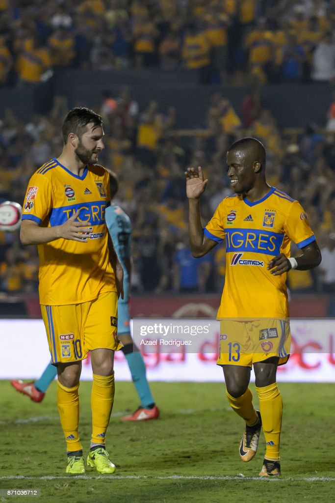 Enner Valencia of Tigres celebrates with teammate Andre-Pierre Gignac after scoring his team's first goal during the 16th round match between Tigres UANL and Necaxa as part of the Torneo Apertura 2017 Liga MX at Universitario Stadium on November 5, 2017 in Monterrey, Mexico.