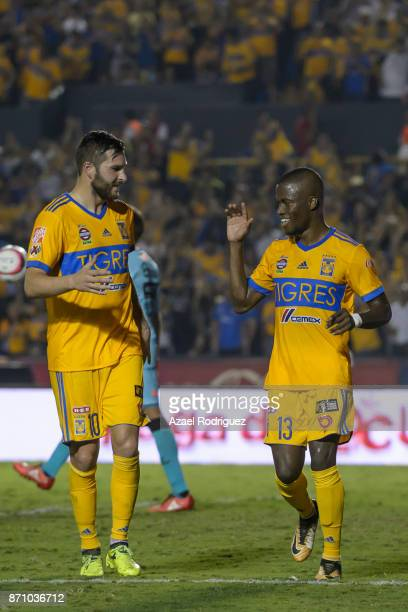 Enner Valencia of Tigres celebrates with teammate AndrePierre Gignac after scoring his team's first goal during the 16th round match between Tigres...