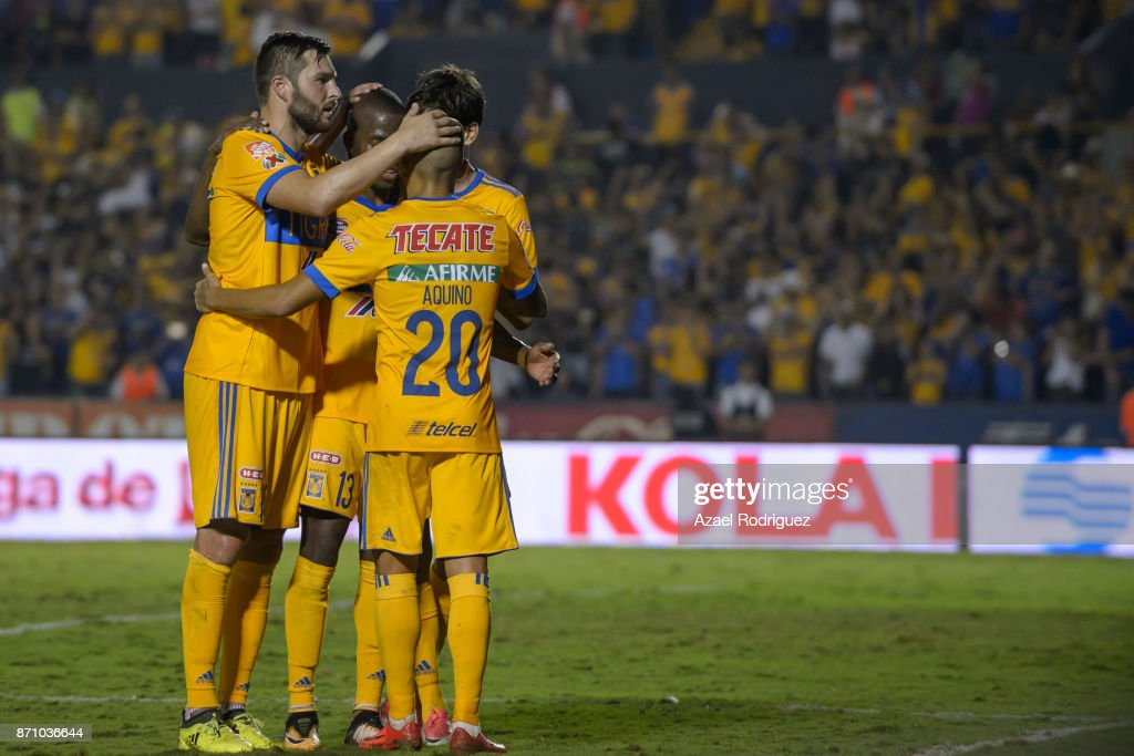 Enner Valencia of Tigres celebrates with teammates after scoring his team's first goal during the 16th round match between Tigres UANL and Necaxa as part of the Torneo Apertura 2017 Liga MX at Universitario Stadium on November 5, 2017 in Monterrey, Mexico.