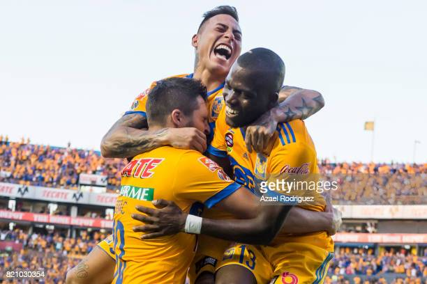 Enner Valencia of Tigres celebrates with teammates Andre Gignac and Eduardo Vargas after scoring his team's fifth goal during the 1st round match...