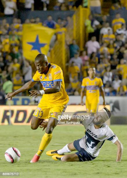 Enner Valencia of Tigres fights for the ball with Luis Quintana of Pumas during the 5th round match between Tigres and Pumas as part of the Torneo...