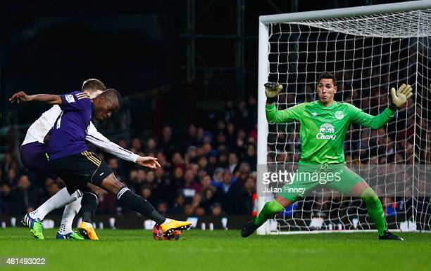 Enner Valencia of West Ham United shoots past goalkeeper Joel Robles of Everton to score their first goal during the FA Cup Third Round Replay match...