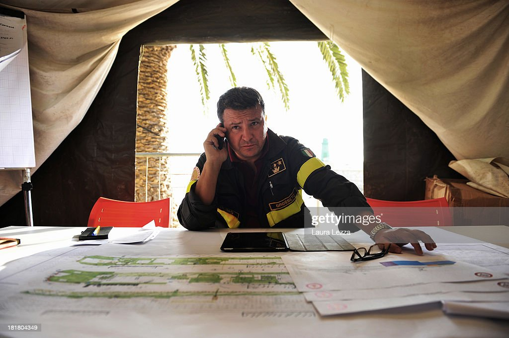 Ennio Aquilino, the Search Operations Director for Costa Concordia victims, uses his phone after a briefing on September 25, 2013 in Giglio Porto, Italy. Yesterday the search resumed for the missing bodies of Maria Grazia Trecarichi and Russel Rebello, whose bodies were never found after the Costa Concordia capsized on January 13, 2012, leaving 32 people dead. Specialist divers from the coastguard, fire brigade, navy and police have begun searching the area between the righted ship and the coast and other parts of the vessel which were previously off limits.