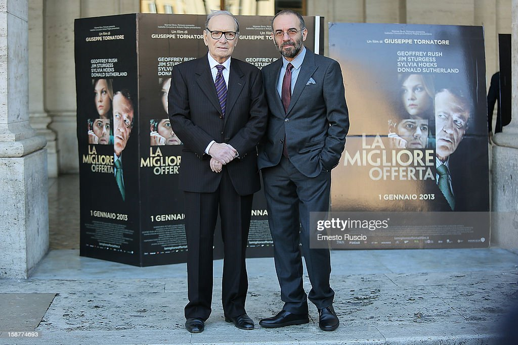 <a gi-track='captionPersonalityLinkClicked' href=/galleries/search?phrase=Ennio+Morricone&family=editorial&specificpeople=677347 ng-click='$event.stopPropagation()'>Ennio Morricone</a> and <a gi-track='captionPersonalityLinkClicked' href=/galleries/search?phrase=Giuseppe+Tornatore&family=editorial&specificpeople=2761023 ng-click='$event.stopPropagation()'>Giuseppe Tornatore</a> attend the 'La Migliore Offerta' photocall at The Space Moderno on December 28, 2012 in Rome, Italy.