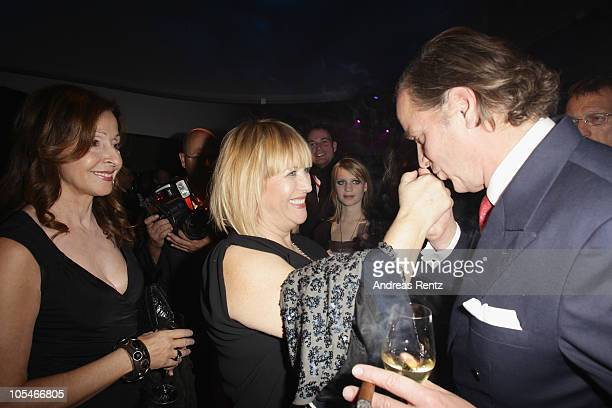 Enno von Ruffin gives a hand kiss to Patricia Riekel as Vicky Leandros smiles during the after show party to the 'Tribute to Bambi' Charity Gala at...