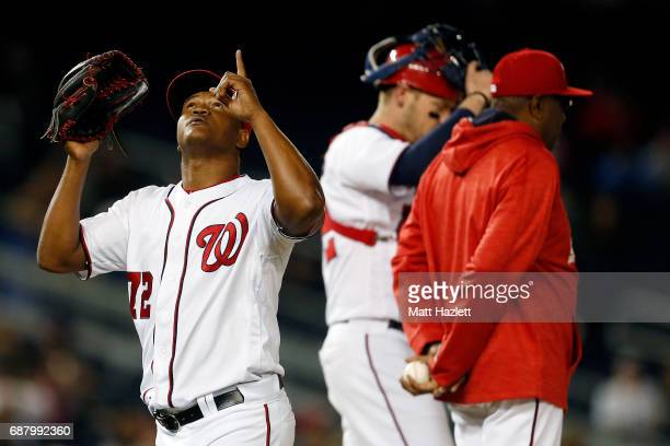 Enny Romero of the Washington Nationals reacts after being relieved in the eighth inning by manager Dusty Baker against the Seattle Mariners during...