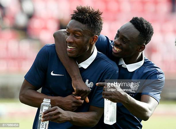 Enock Kwateng and JeanKevin Augustin of France celebrate victory after the UEFA European U19 Championship Elite Round Group 7 match between Serbia...