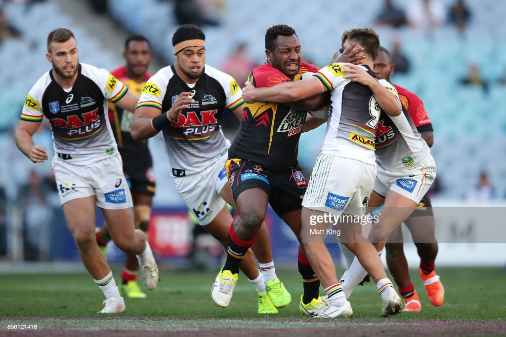 Enock Maki of the Hunters is tackled during the 2017 State Championship Final between the Penrith Panthers and Papua New Guinea Hunters at ANZ Stadium on October 1, 2017 in Sydney, Australia.