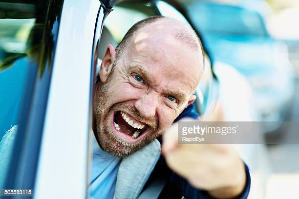 Enraged driver, face a mask of fury, loses his temper