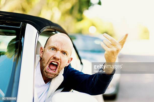 Enraged male driver shouts and gestures threateningly