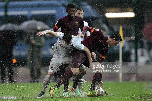 Enrico Baldini of FC Internazionale battles for the ball with Riccardo Marchizza of AS Roma during the Viareggio Juvenile Tournament match between FC...