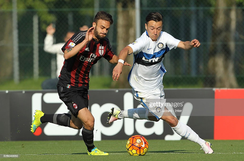 Enrico Baldini (R) of FC Internazionale competes for the ball with Guido Turano (L) of AC Milan during the juvenile match between AC Milan and FC Internazionale at Centro Sportivo Giuriati on April 29, 2016 in Milan, Italy.