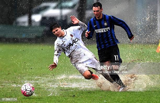 Enrico Baldini of FC Internazionale competes for the ball with Alessio Gulinatti of Bologna FC during the juvenile match between FC Internazionale...