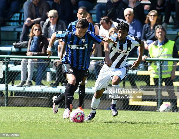 Enrico Baldini of FC Internazionale competes for the ball with Taha Ben Hezzedi Maghzaoui of Udinese Calcio during the juvenile match between FC...