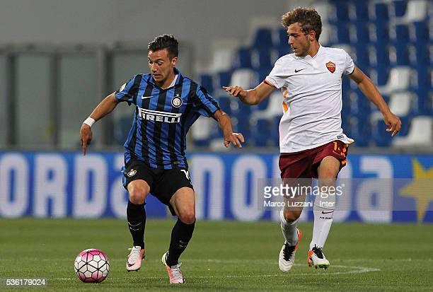 Enrico Baldini of FC Internazionale is challenged by Eros De Santis of AS Roma during the juvenile playoff match between FC Internazionale and AS...