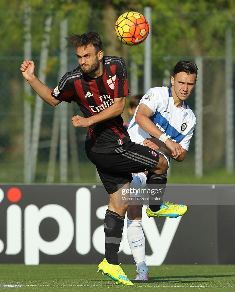 Enrico Baldini (R) of FC Internazionale is challenged by Guido Turano (L) of AC Milan during the juvenile match between AC Milan and FC Internazionale at Centro Sportivo Giuriati on April 29, 2016 in Milan, Italy.