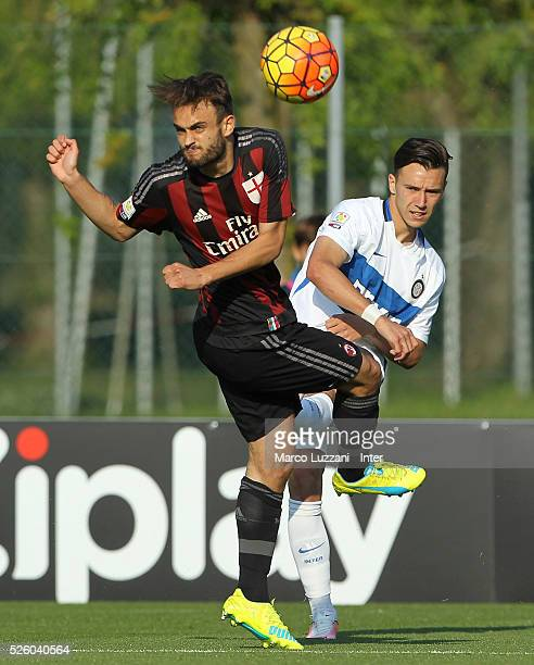 Enrico Baldini of FC Internazionale is challenged by Guido Turano of AC Milan during the juvenile match between AC Milan and FC Internazionale at...