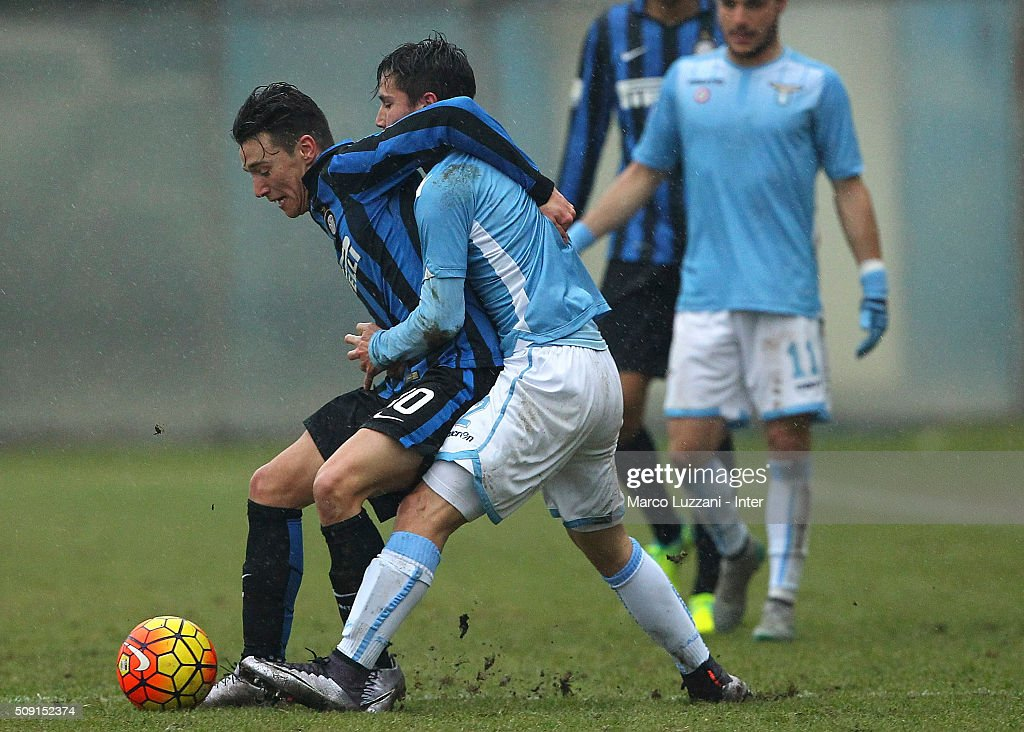 Enrico Baldini of FC Internazionale Milano competes for the ball with Cristiano Dovidio of SS Lazio during the juvenile TIM cup match between FC Internazionale and SS Lazio at Stadio Breda on February 9, 2016 in Sesto San Giovanni, Italy.