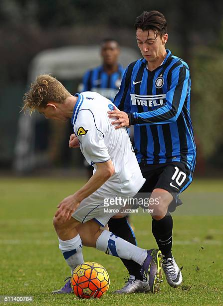 Enrico Baldini of FC Internazionale Milano competes for the ball with Paolo Bodei of Brescia Calcio during the juvenile match between FC...