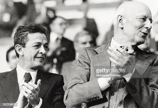 Enrico Berlinguer general secretary of the Italian Communist Party from 1972 until 1984 is applauding with Giancarlo Pajetta Italian politician and...