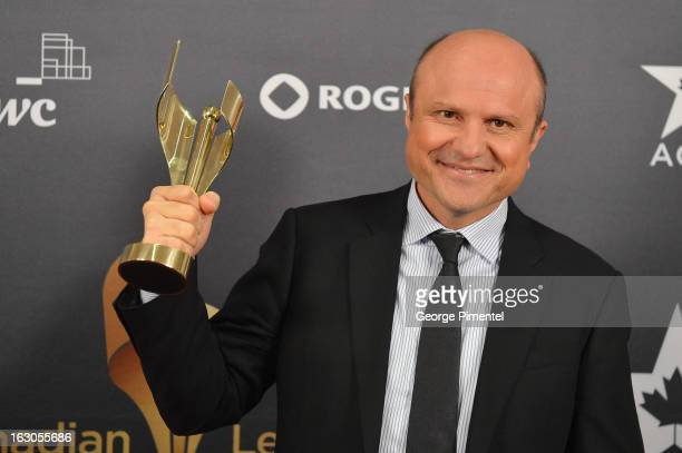 Enrico Colantoni winner of best performance by an actor in a continuing leading dramatic role poses in the press room at the 2013 Canadian Screen...