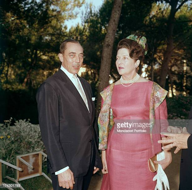 Enrico d'Orléans better known as the Count of Paris talking to his wife Isabella d'Orléans Braganza during an open air reception 1964