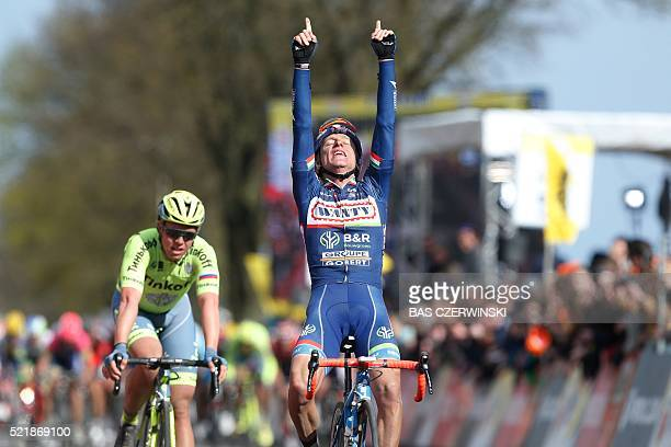 TOPSHOT Enrico Gasparotto from Italy raises his arms in victory as he crosses the finish line of the Amstel Gold Race cycling race on April 17 2016...