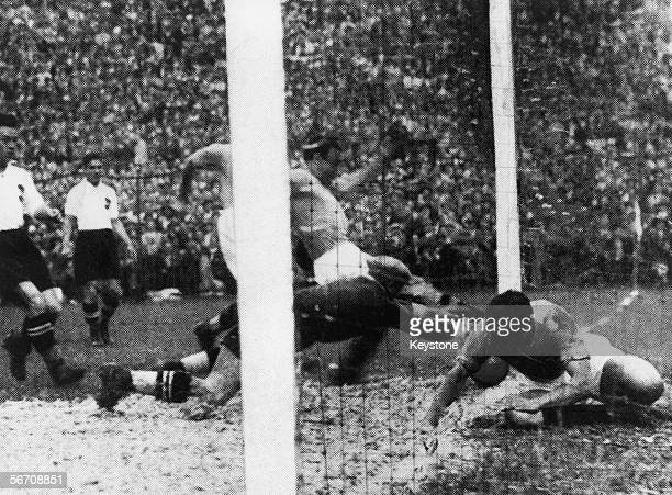 Enrico Guaita of Italy scores ten minutes into his team's World Cup semifinal against Austria at San Siro Milan 3rd June 1934 Italy won the match 10...