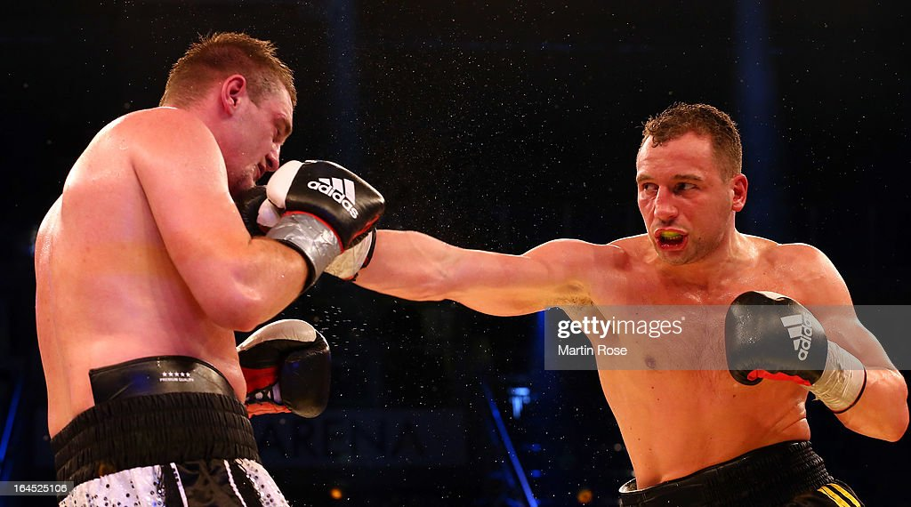 Enrico Koelling (R) of Germany and Josef Obeslo (L) of Czech Republic exchange punches during the Light Heavyweight fight at Getec Arena on March 23, 2013 in Magdeburg, Germany.