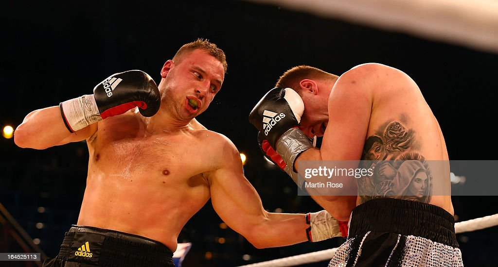 Enrico Koelling (L) of Germany and Josef Obeslo (R) of Czech Republic exchange punches during the Light Heavyweight fight at Getec Arena on March 23, 2013 in Magdeburg, Germany.