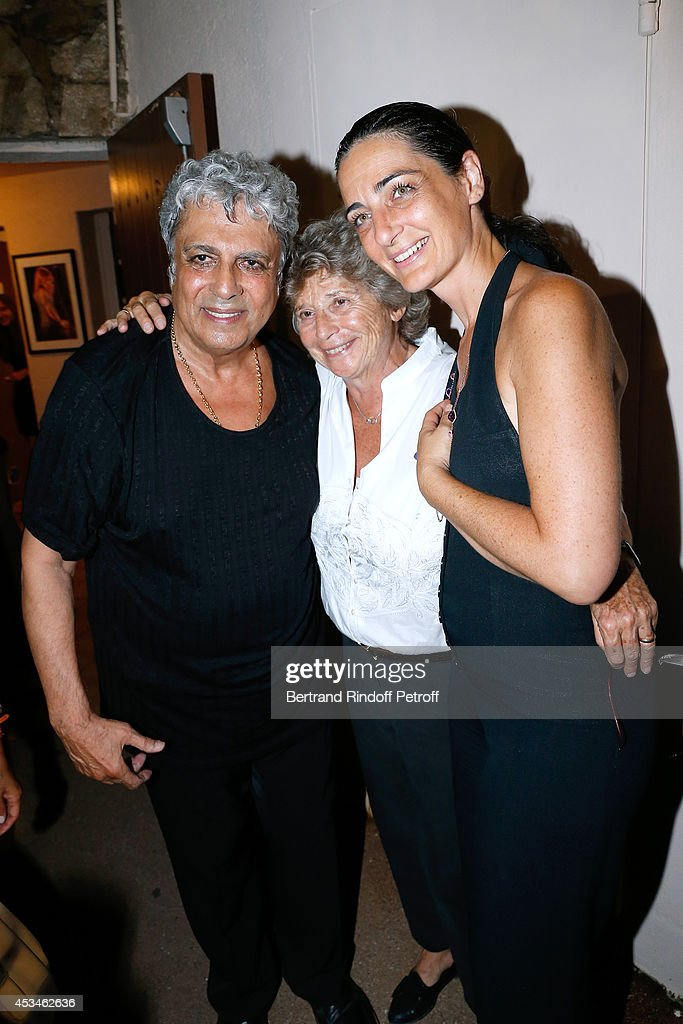 <a gi-track='captionPersonalityLinkClicked' href=/galleries/search?phrase=Enrico+Macias&family=editorial&specificpeople=2057443 ng-click='$event.stopPropagation()'>Enrico Macias</a>, President of Ramatuelle Festival Jacqueline Franjou and daughter of Charley Marouani, Rachel Marouani pose after the concert of singer <a gi-track='captionPersonalityLinkClicked' href=/galleries/search?phrase=Enrico+Macias&family=editorial&specificpeople=2057443 ng-click='$event.stopPropagation()'>Enrico Macias</a> at the 30th Ramatuelle Festival : Day 10 on August 10, 2014 in Ramatuelle, France.