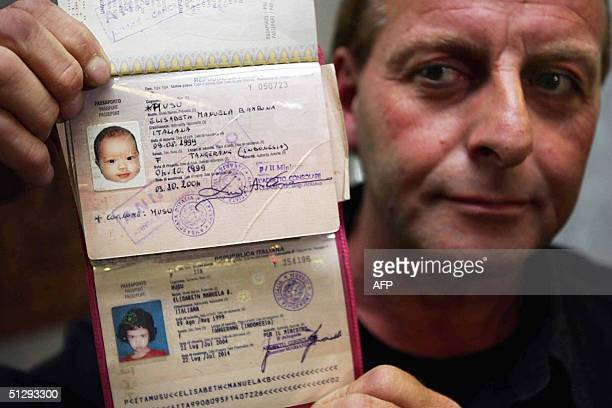 Enrico Musu the grandfather of a fiveyearold Elisabeth Manuela Banbin Musu shows the Italian passport of the little girl at Mount Elisabeth hospital...