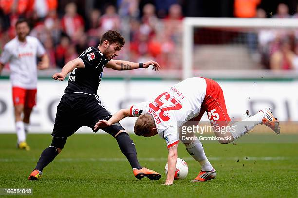 Enrico Valentini of VfR Aalen challenges Daniel Royer of 1 FC Koeln during the Second Bundesliga match between 1 FC Koeln and VfR Aalen at...