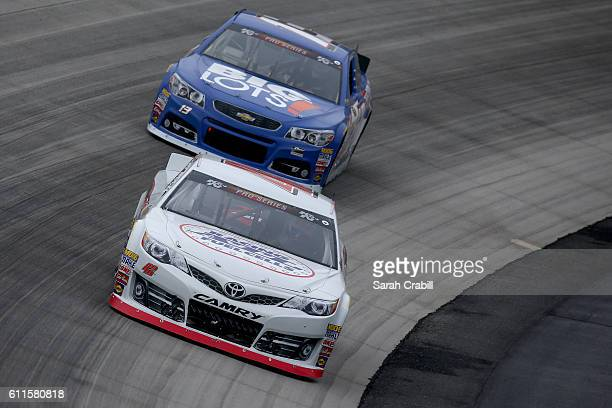 Enrique Baca driver of the Honda Generators Toyota and Hunter Baize driver of the Bicycle Playing Cards/Pine Mountains Firelogs Chevrolet practice...