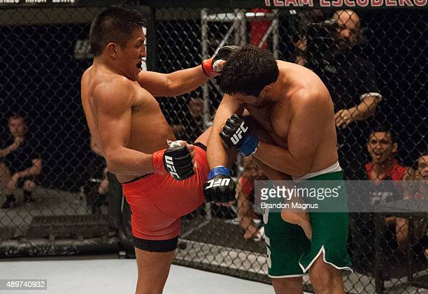 Enrique Barzola knees Jonathan Ortega during the filming of The Ultimate Fighter Latin America Team Gastelum vs Team Escudero on April 7 2015 in Las...