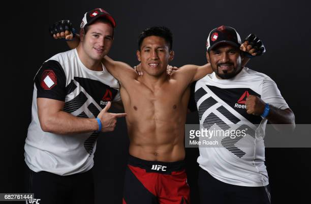 Enrique Barzola of Peru poses for a post fight portrait backstage with his team during the UFC 211 event at the American Airlines Center on May 13...
