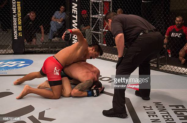 Enrique Barzola punches Cesar Arsamendia in their semifinals fight during the filming of The Ultimate Fighter Latin America Team Gastelum vs Team...