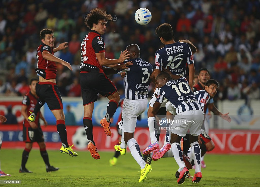 Enrique Esqueda of Atlas struggles for the ball with <a gi-track='captionPersonalityLinkClicked' href=/galleries/search?phrase=Aquivaldo+Mosquera&family=editorial&specificpeople=624234 ng-click='$event.stopPropagation()'>Aquivaldo Mosquera</a>, Erick Gutierrez and Walter Ayovi of Pachuca during a match between Pachuca and Atlas as part of 6th round Apertura 2014 Liga MX at Hidalgo Stadium on August 23, 2014 in Pachuca, Mexico.