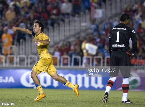 Enrique Esquerda of America of Mexico runs to celebrates his goal as Flamengo's goalkeeper Bruno Fernandes reacts on May 7 during their Libertadores...
