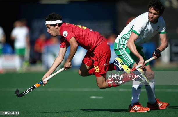 Enrique Gonzalez of Spain and Chris Cargo of Ireland battle for possession during the Quarter final match between Spain and Ireland during Day 6 of...