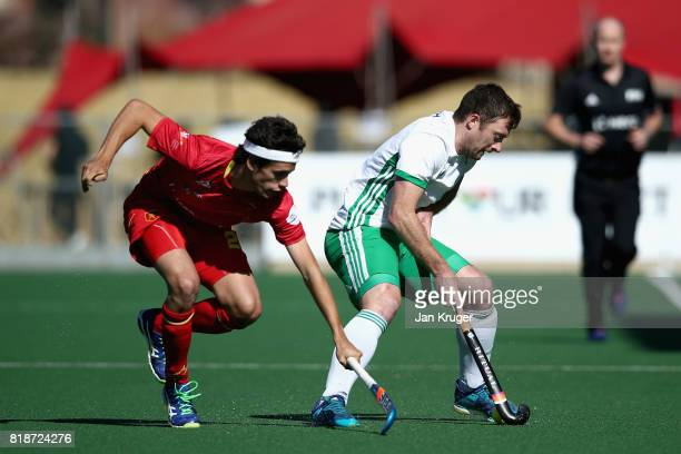 Enrique Gonzalez of Spain and John Jackson of Ireland battle for possession during the Quarter final match between Spain and Ireland during Day 6 of...