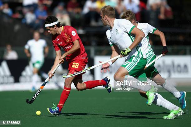 Enrique Gonzalez of Spain attempts to get away from Conor Harte of Ireland during the Quarter final match between Spain and Ireland during Day 6 of...