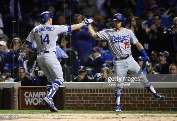 Enrique Hernandez and Austin Barnes of the Los Angeles Dodgers celebrate after Hernandez hit a home run in the second inning against the Chicago Cubs...