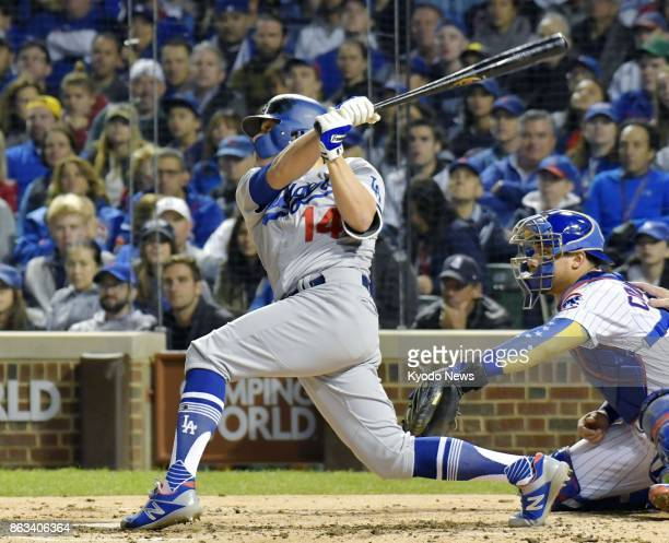 Enrique Hernandez hits a grand slam in the third inning of the Los Angeles Dodgers' 111 victory over the Chicago Cubs in Game 5 of the National...