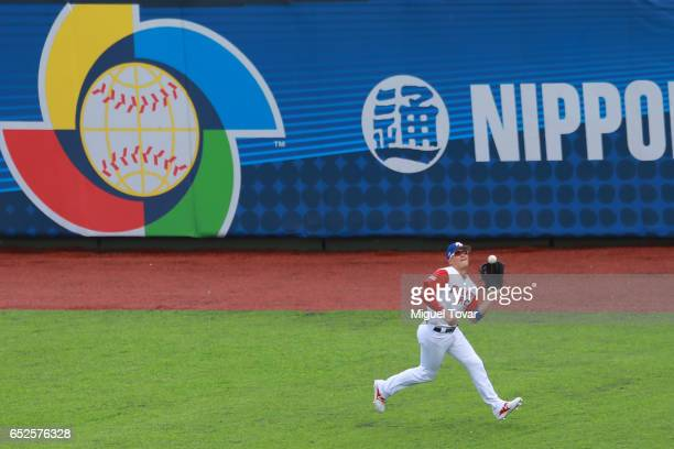 Enrique Hernandez of Puerto Rico catches a fly in the top of the first inning during the World Baseball Classic Pool D Game 5 between Italy and...