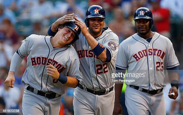 Enrique Hernandez of the Houston Astros celebrates with Carlos Corporan of the Houston Astros and Chris Carter of the Houston Astros after they...