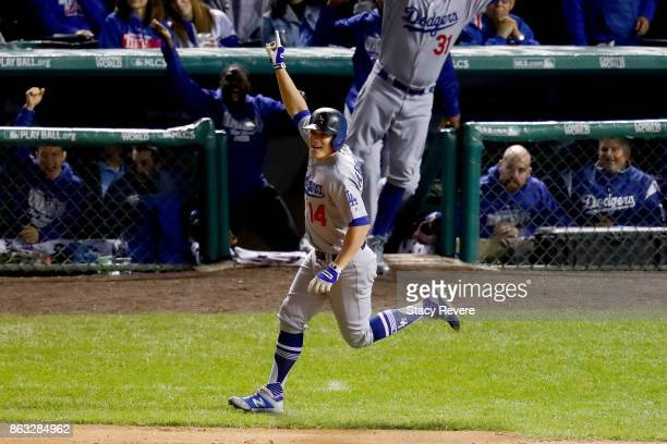 Enrique Hernandez of the Los Angeles Dodgers celebrates after hitting a home run in the ninth inning against the Chicago Cubs during game five of the...