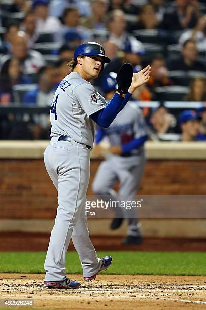 Enrique Hernandez of the Los Angeles Dodgers celebrates after scoring a run off of Adrian Gonzalez single to center field against Steven Matz of the...