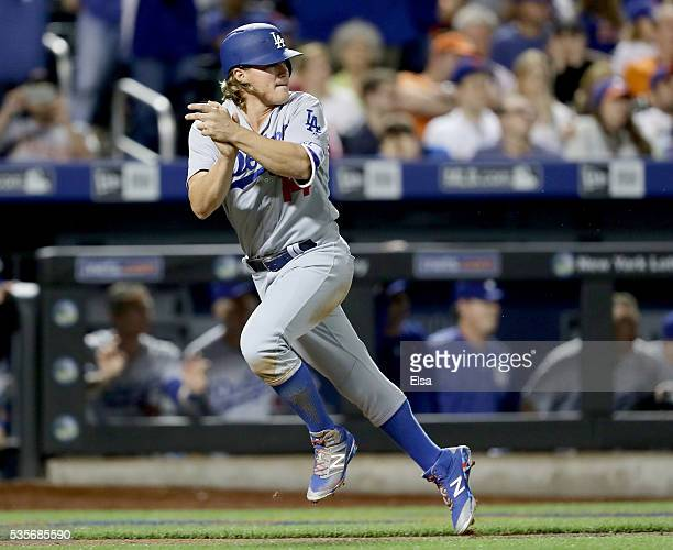 Enrique Hernandez of the Los Angeles Dodgers celebrates as he scores in the ninth inning against the New York Mets at Citi Field on May 29 2016 in...